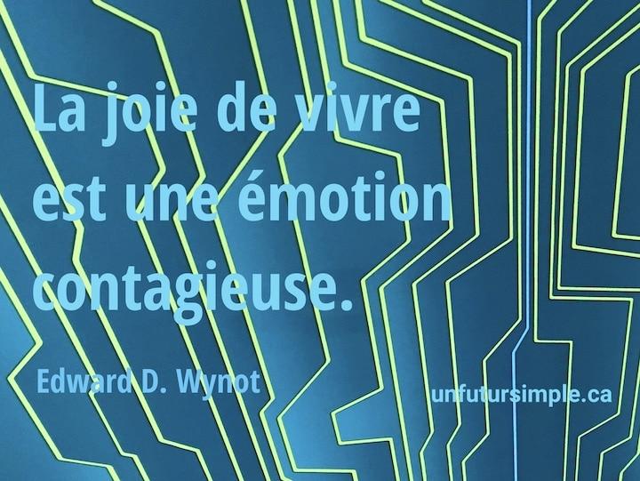 Citation de Edward D. Wynot: La joie de vivre est une émotion contagieuse. Arrière-plan: Fines lignes géométriques jaune fluo sur un fond bleu et turquoise;